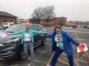 """Ta-da"" posing Aquinas health employees."