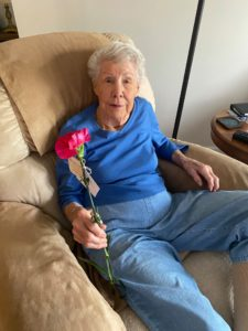 Gorgeous grandma with a carnation.