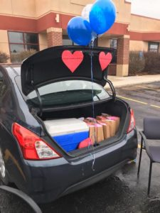 Care packages in the trunk of a car.